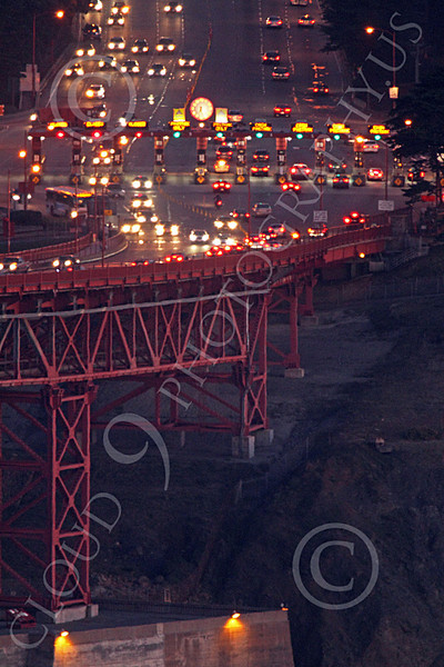 ENGF-GGB 00183 A tight crop of the Golden Gate Bridge's south end ticket booth with traffic, at night, by Peter J Mancus