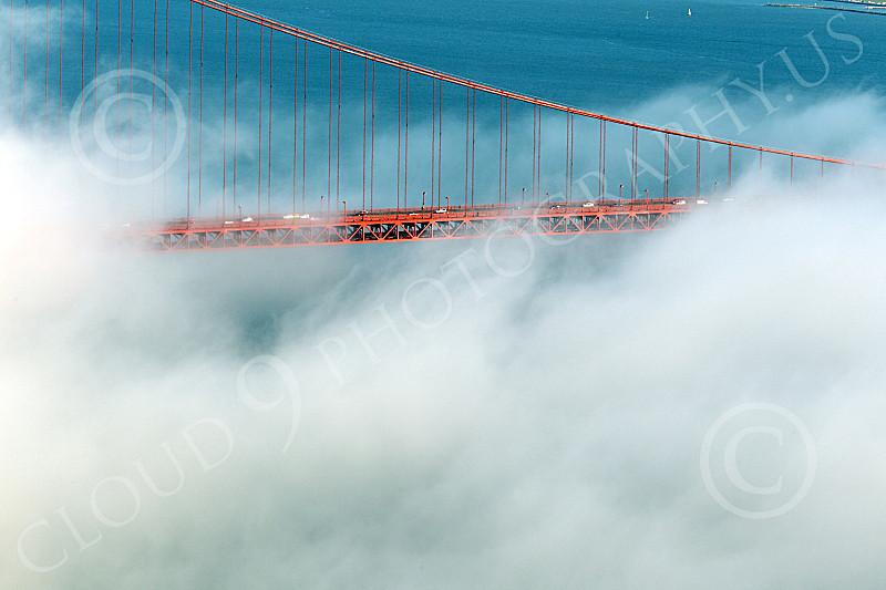 ENGF-GGB 00260 A tight crop of part of the Golden Gate Bridge's suspended roadway, in fog, by Peter J Mancus