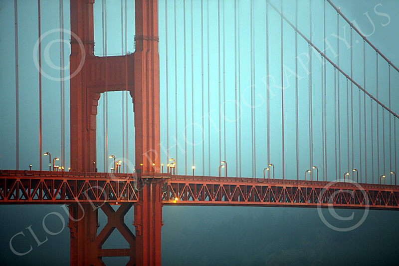 ENGF-GGB 00014A Detail shot of the Golden Gate Bridge at twilight in fog, by Peter J Mancus