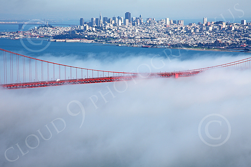 ENGF-GGB 00086 A tight crop of the Golden Gate Bridge's mid span, in fog, with San Francisco in the background, by Peter J Mancus