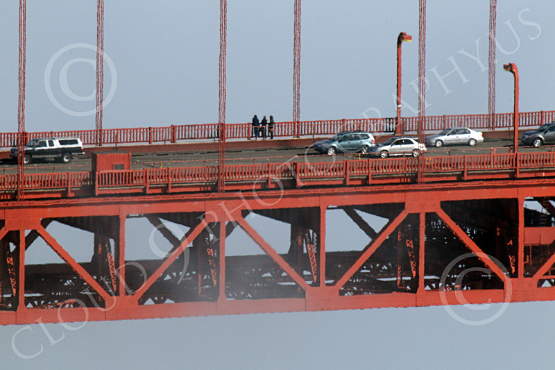 ENGF-GGB 00276 A tight crop of part of the Golden Gate Bridge's suspended roadway, with traffic, admist fog, by Peter J Mancus