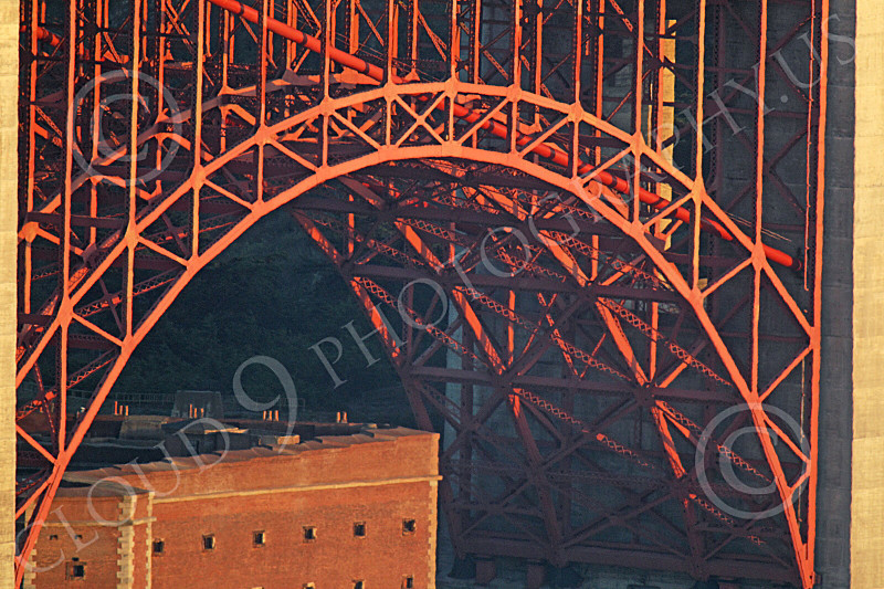ENGF-GGB 00178 A tight crop of part of the Golden Gate Bridge's south end underlying intricate metal support structure, by Peter J Mancus