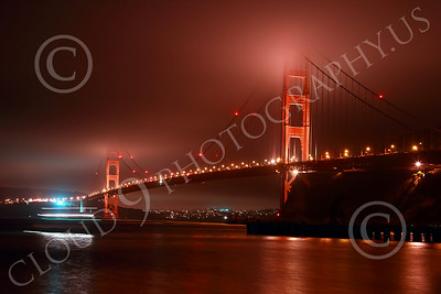 ENGF-GGB 00301 A time lapse picture of the northeast view of the Golden Gate Bridge at night with a moving boat on lower left corner by Peter J Mancus