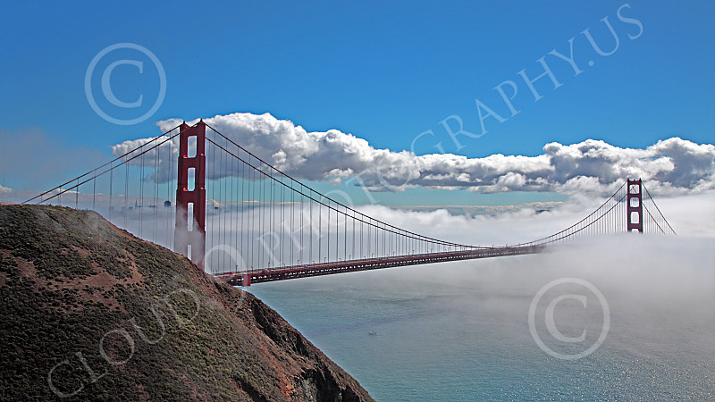 ENGF-GGB 00038 A highlands south view of the Golden Gate Bridge amidst fog and clouds, by Peter J Mancus