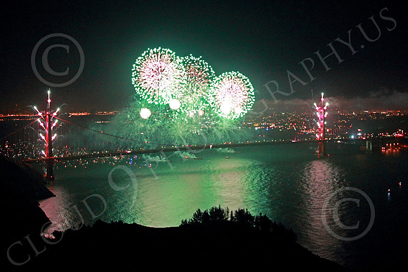 ENGF-GGB 00310 Three big green fireworks burst over the Golden Gate Bridge to celebrate a landmark anniversary picture by Peter J Mancus