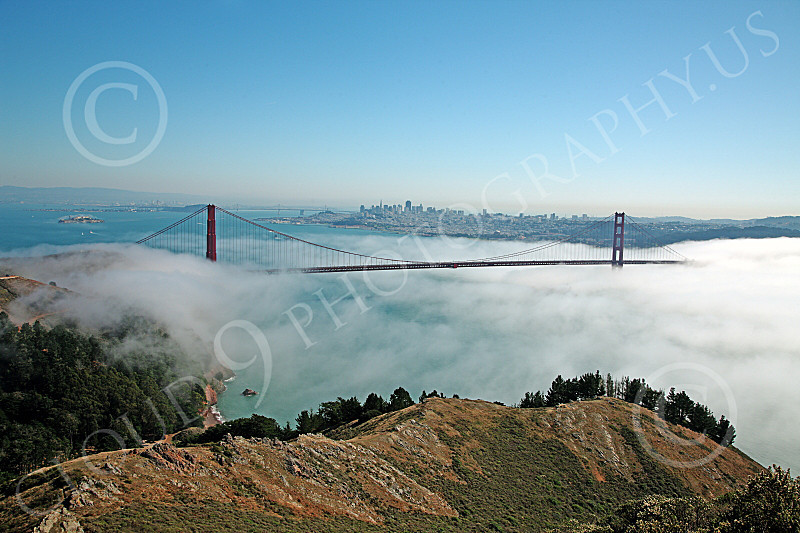 ENGF-GGB 00154 Expansive view of the Golden Gate Bridge in daylight with fog and Alcatraz Island on the left, by Peter J Mancus