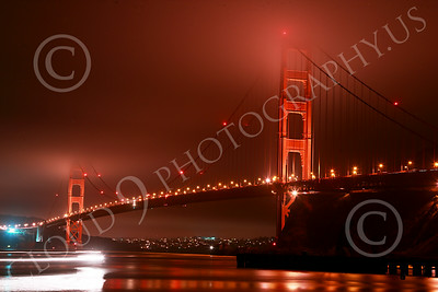 ENGF-GGB 00211 A time lapse picture of the northeast view of the Golden Gate Bridge at night with a moving boat on lower left corner by Peter J Mancus