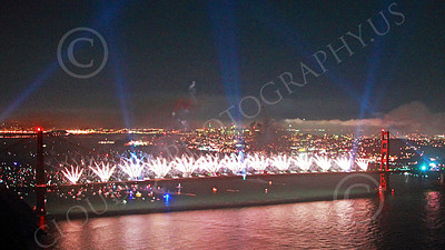ENGF-GGB 00373 White fireworks erupt along the Golden Gate Bridge to celebrate a landmark anniversary picture by Peter J Mancus