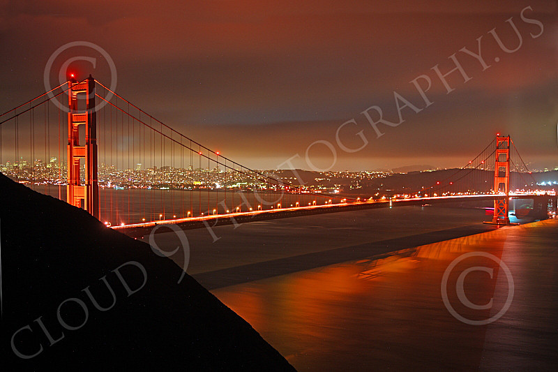 ENGF-GGB 00039 A Golden Gate Bridge night scene, looking at it and San Francisco in the background, by Peter J Mancus