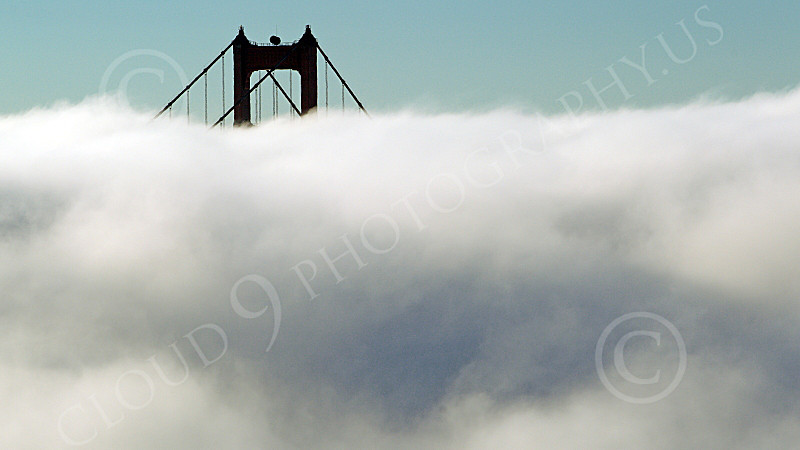 ENGF-GGB 00185 Fog surrounds the Golden Gate Bridge's north tower, by Peter J Mancus