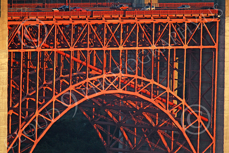 ENGF-GGB 00136 A tight crop of part of the Golden Gate Bridge's south end underlying intricate metal support structure, by Peter J Mancus