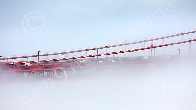 ENGF-GGB 00093 A tight crop of part of the Golden Gate Bridge engulfed by thick fog, by Peter J Mancus