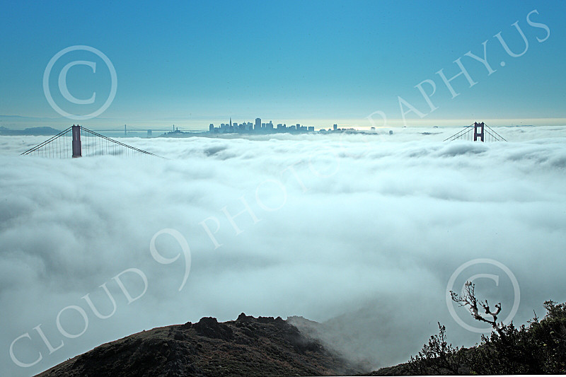 ENGF-GGB 00102 The Golden Gate Bridge's towers' tops remain clear of thick fog, with San Francisco in the background, by Peter J Mancus