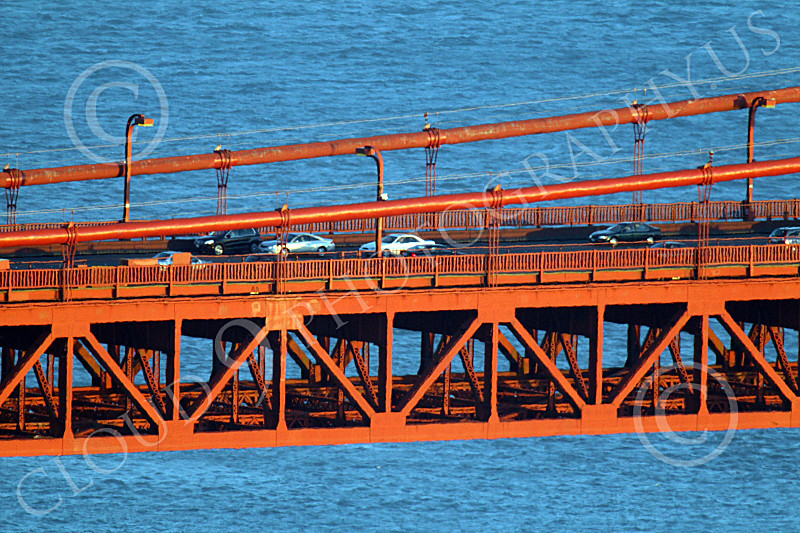 ENGF-GGB 00212 A tight crop of part of the Golden Gate Bridge's suspended roadway with traffic, by Peter J Mancus