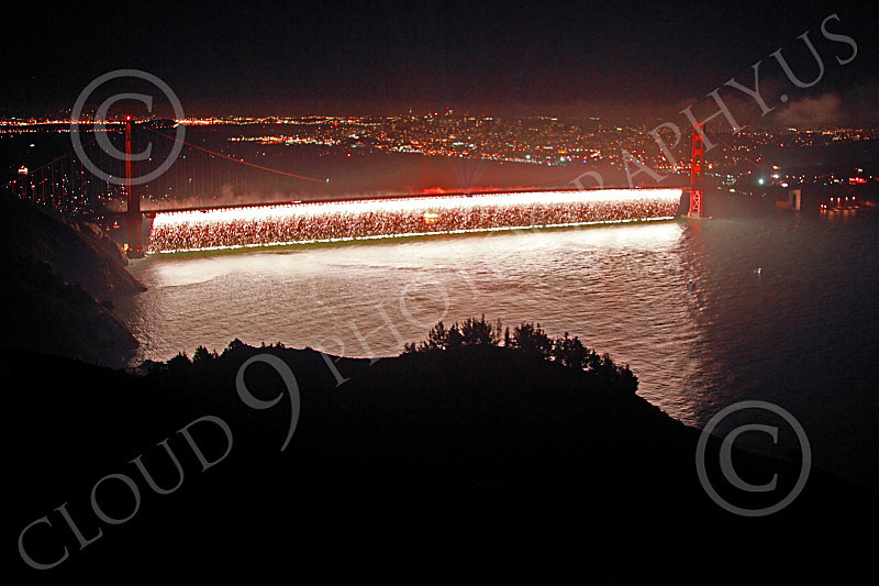ENGF-GGB 00339 White fireworks burst below across the Golden Gate Bridge to celebrate a landmark anniversary picture by Peter J Mancus