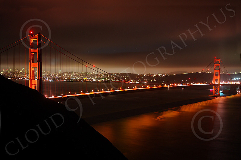 ENGF-GGB 00124 A Golden Gate Bridge night scene, looking at it and San Francisco in the background, by Peter J Mancus