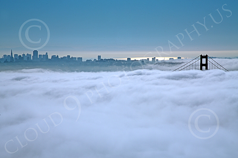 ENGF-GGB 00063 The top of the south tower of the Golden Gate Bridge is seen above extensive fog, by Peter J Mancus