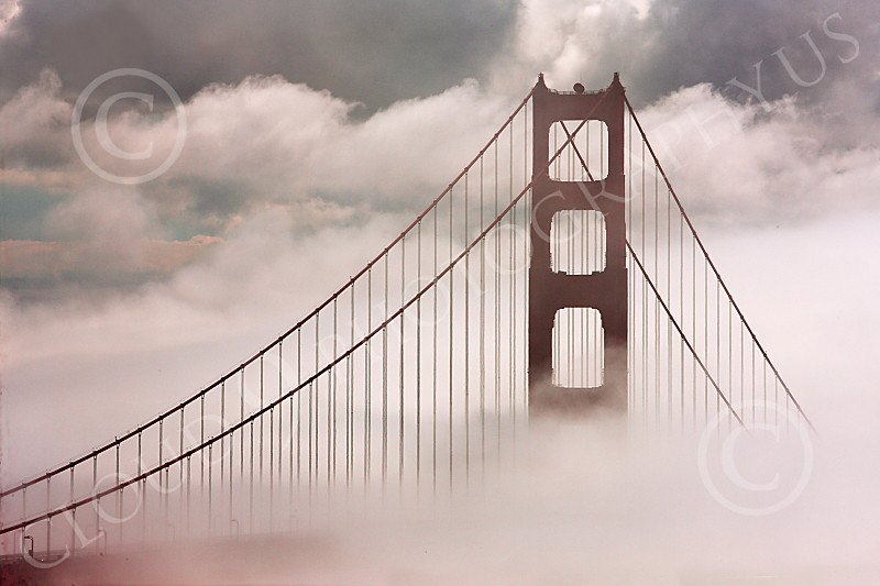 ENGF-GGB 00041 A highlands south view of the south tower of the Golden Gate Bridge in thick fog and clouds, by Peter J Mancus