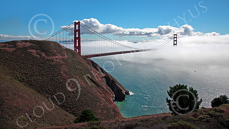 ENGF-GGB 00047 A highlands south view of the Golden Gate Bridge amidst fog and clouds, by Peter J Mancus