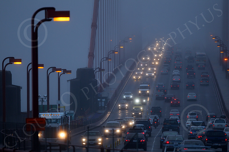 ENGF-GGB 00030 Twilight early morning vehicular traffic on the north end of the Golden Gate Bridge, by Peter J Mancus