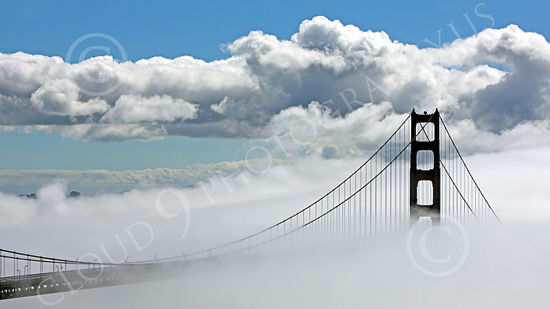 ENGF-GGB 00049 A highlands south view of the south tower of the Golden Gate Bridge amidst fog and clouds, by Peter J Mancus