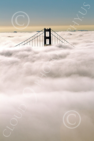 ENGF-GGB 00269 A Golden Gate Bridge above thick fog, by Peter J Mancus