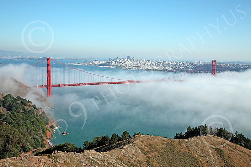 ENGF-GGB 00074 The Golden Gate Bridge seen in a combination of daylight and fog, with San Francisco in the background, by Peter J Mancus