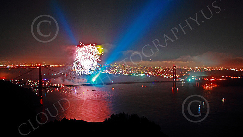 ENGF-GGB 00368 Fireworks and a blue searchlight underscore a Golden Gate Bridge landmark anniversary picture by Peter J Mancus