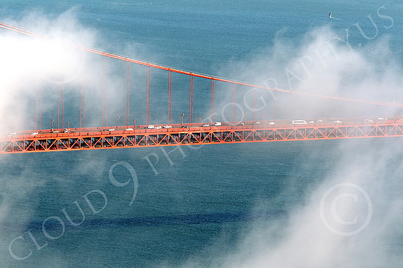 ENGF-GGB 00240 A tight crop of part of the Golden Gate Bridge's suspended roadway, with fog, by Peter J Mancus