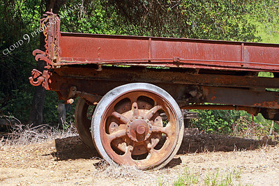 AMER-WagW 00002 Right rear metal wheel on an old metal mining wagon at Angel's Camp, California by Peter J Mancus