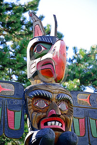 TotPol 00013 A colorful, well carved, detailed, interesting, semi-scary face, totem pole detail, totem pole picture by Peter J  Mancus