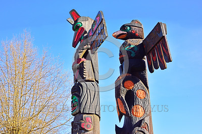 TotPol 00022 Two different style bird of prey faced totem pole details, totem pole picture by Peter J Mancus