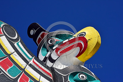 TotPol 00024 Close up of a well done good condition colorful bred of prey inspired totem pole, totem pole picture by Peter J Mancus