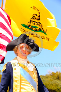 "HR-GenGWash 00003 A General George Washington historical re-enactor stands defiantly before the ""DON'T TREAD ON ME"" flag, historical re-enactor picture by Peter J Mancus"
