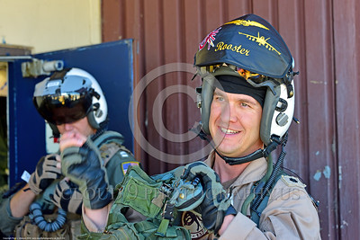 ACM 00432 Portrait of a US Navy Boeing EA-18 Growler EWO Electronic Warfare Officer in helmet with protective cover over raised visor, getting ready for a flight at NAS Fallon 7-2016, aircrew picture by Peter J  Mancus