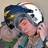 ACM 00437 A US Navy VAQ-132 SCORPIONS EA-18 Growler pilot, call sign DADDY, snaps his helmet strap before a mission at NAS Fallon 7-2016, aircrew  picture by Peter J  Mancus