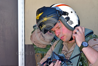 ACM 00428 A US Navy VAQ-132 SCORPIONS EA-18 Growler pilot, call sign DADDY, snaps his helmet strap before a mission at NAS Fallon 7-2016, aircrew  picture by Peter J  Mancus