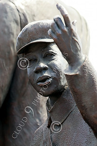 STY-BFREE 00021 A young Black child raises his hand behind his relatives, in a statue that celebrates Black freedom, statue picture by Peter J Mancus