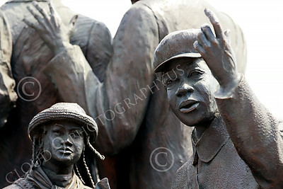 STY-BFREE 00014 Young Black children, ex-slaves, behind their relatives, in a statue that celebrates Black freedom, statue picture by Peter J Mancus