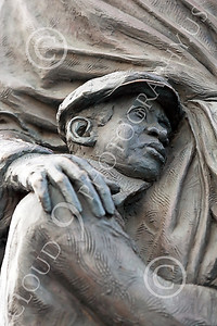 STY-BFREE 00017 Face of a young Black child, an ex-slave, in a statue celebrating Black freedom, statue picture by Peter J Mancus