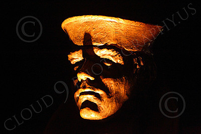 STY - The Lone Sailor 00020 A tight crop quarter front view of the head of the The Lone Sailor statute at night, by Peter J Mancus