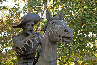 STY - PEXP 00004 Pony express rider with a whip on his horse by Peter J Mancus