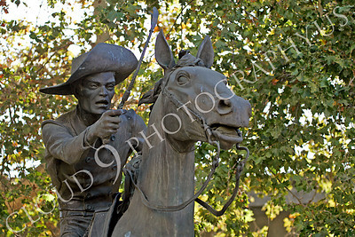 STY - PEXP 00008 Pony express rider with a whip on his horse by Peter J Mancus