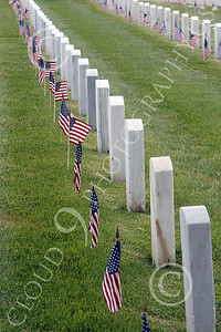 AMER-MilCem 00009 Flags and tombstones against grass at a US military cemetery on Memorial Day, by Peter J Mancus