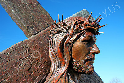 SpMis 00162 A close up of Jesus carrying his crucification cross, statuary at Mission San Louis Rey, by Peter J Mancus