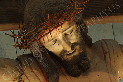 SpMis 00150 A tight crop of the head of an artistic representation of a crucified Jesus Christ above the altar at Mission San Louis Rey, by Peter J Mancus