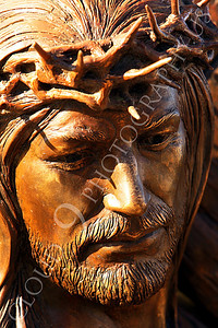 SpMis 00155 A tight crop of a crown on thorns on Jesus' head while carrying a crucification cross, statuary at Mission San Louis Rey, by Peter J Mancus