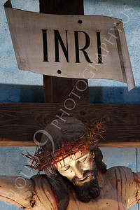 SpMis 00159 A vertical tight crop of an artistic representation of a crucified Jesus Christ above the altar at Mission San Louis Rey, by Peter J Mancus