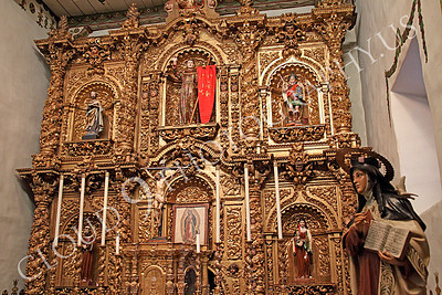 SpMis 00148 The color gold dominates the altar inside the chapel at Mission San Juan Capistrano, by Peter J Mancus