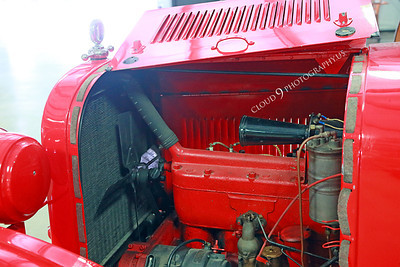 AMER-Auto 00004 Open engine compartment for an old red City of Angels gas powered fire truck at Angel's Camp Museum, California by Peter J Mancus